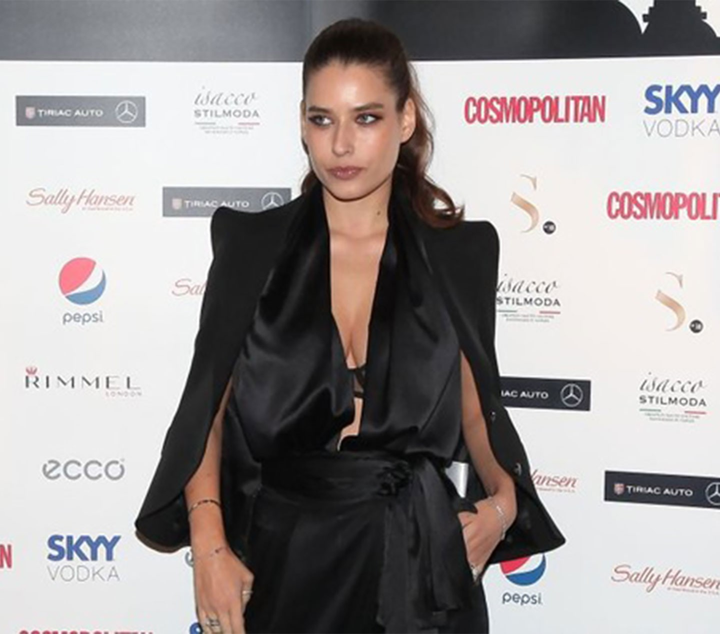 ALICE PENEACA - Wears Black vest with silk top and pants
