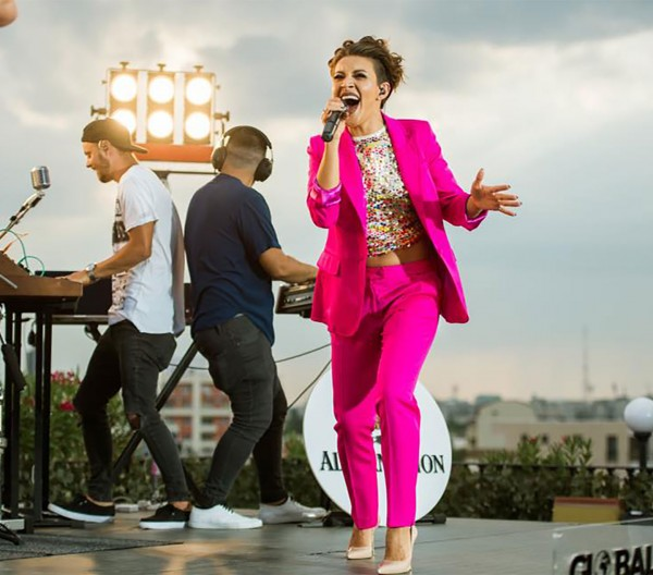 NICOLETA NUCA - Wears Hot Pink suit on the stage