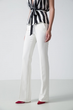 WHITE FLARED PANTS WITH WHITE STRIPE